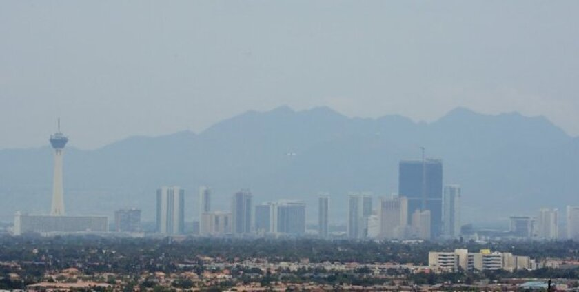 Smoke drifting from the Carpenter 1 fire partly obscures the view of hotel-casinos on the Las Vegas Strip on Thursday. The wildfire forced the closure of hiking trails at Red Rock Canyon.