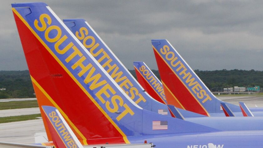 FILE - In this May 16, 2008 file photo, Southwest Airlines jets are seen parked at their gates at B