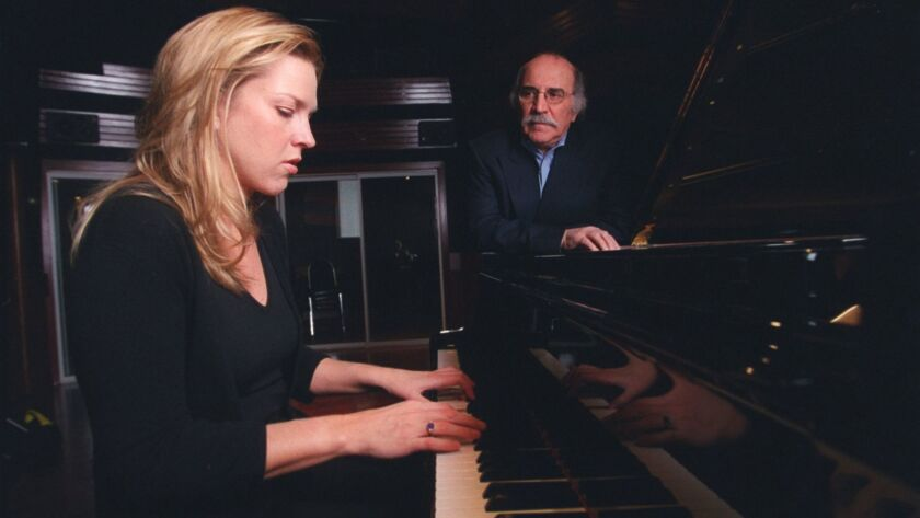 Tommy LiPuma looks on as recording artist Diana Krall works on a new album.