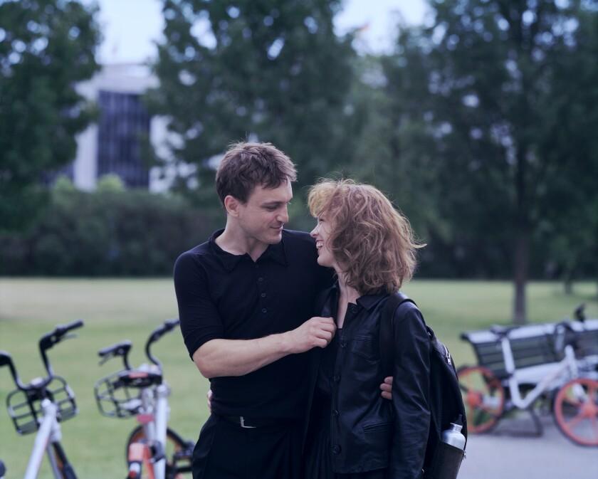 "Franz Rogowski and Paula Beer walk around Berlin in the movie ""Undine."""