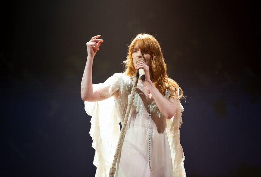 Florence Welch performs in white