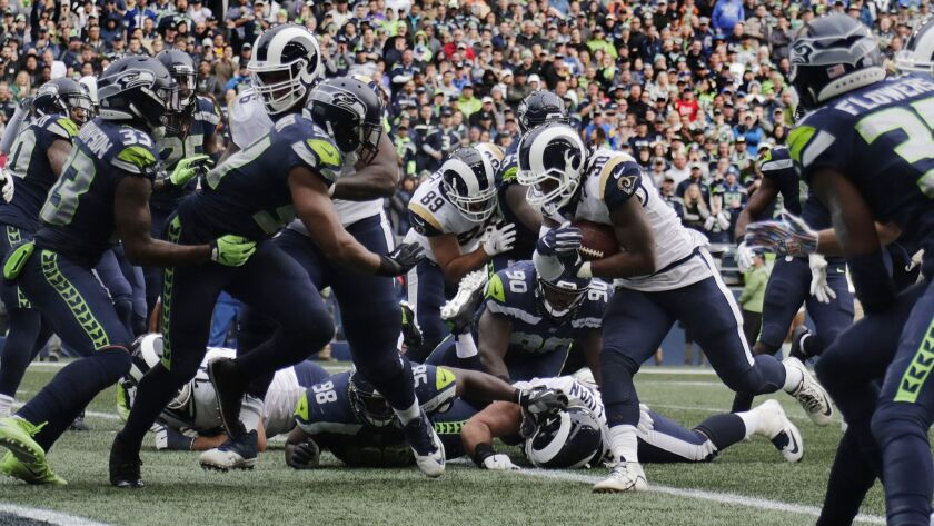 SEATTLE, WA - OCTOBER 7, 2018: Los Angeles Rams running back Todd Gurley (30) finds a hole in the S