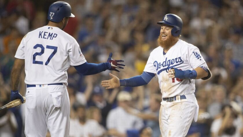 LOS ANGELES, CALIF. -- WEDNESDAY, AUGUST 15, 2018: Dodgers' Matt Kemp, left, congratulates Justin T