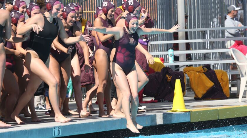 Kristen Smith leads the celebratory plunge after Point Loma defeated Mt. Carmel for the San Diego Section Division III championship Saturday at La Jolla High.