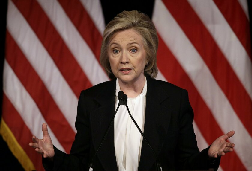 FILE - In this July 13, 2015, file photo, Democratic presidential candidate Hillary Rodham Clinton speaks at a campaign event in New York. Clinton's economic agenda calls for higher taxes on companies that focus on short-term profits and high-speed trading instead of investing in workers. But the Democratic presidential candidate's finance operation is going after their executives for another purpose, campaign money. (AP Photo/Seth Wenig, File)