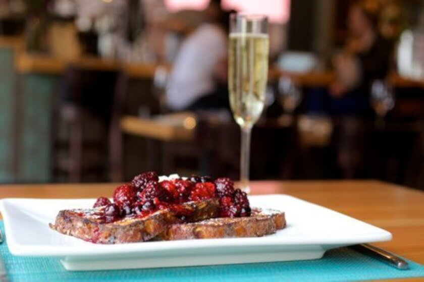 "Table 926's ""Bread Pudding"" is French toast with berry compote, maple syrup and powdered sugar. (Courtesy Photo)"