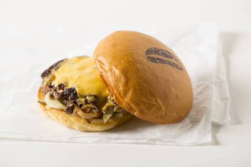 The Dad's Burger at U Mini features onions, bread and butter pickles and housemade cheddar cheese.