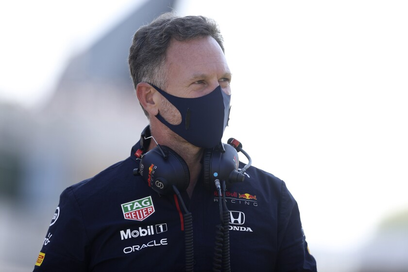 Red Bull Racing team principal Christian Horner walks on the grid before the start of the British Formula One Grand Prix, at the Silverstone circuit, in Silverstone, England, Sunday, July 18, 2021. (Lars Baron/Pool photo via AP)