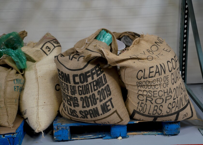 Coffee beans stored in burlap sack sit ready to be roasted on Tuesday, January 14, 2020 at Steady State Roasting Company's new California Roasting Collective warehouse in San Marcos.