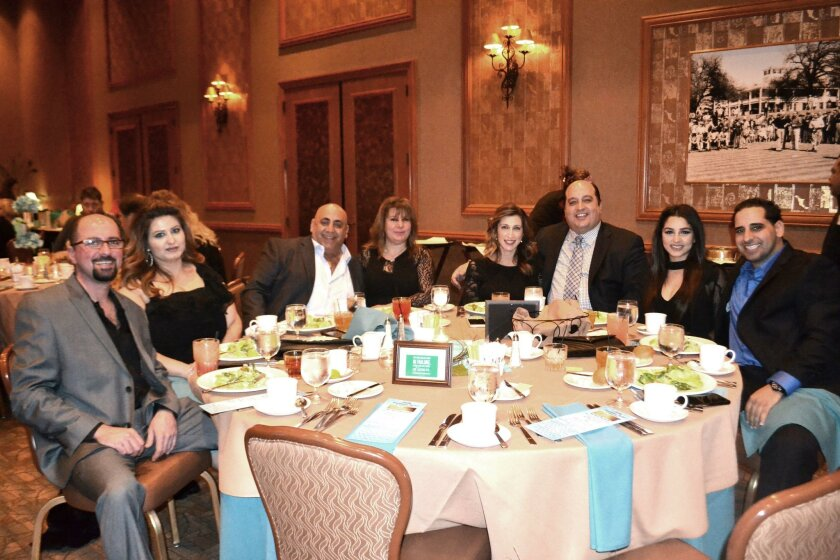 Representing Country Wine & Spirits, winner of the Business of the Year award, are, from left: Mike and Damoei Shamoon, Steve and Ghada Hermiz, Angela and Shawn Kattoula, and Crystal and David Kachi.