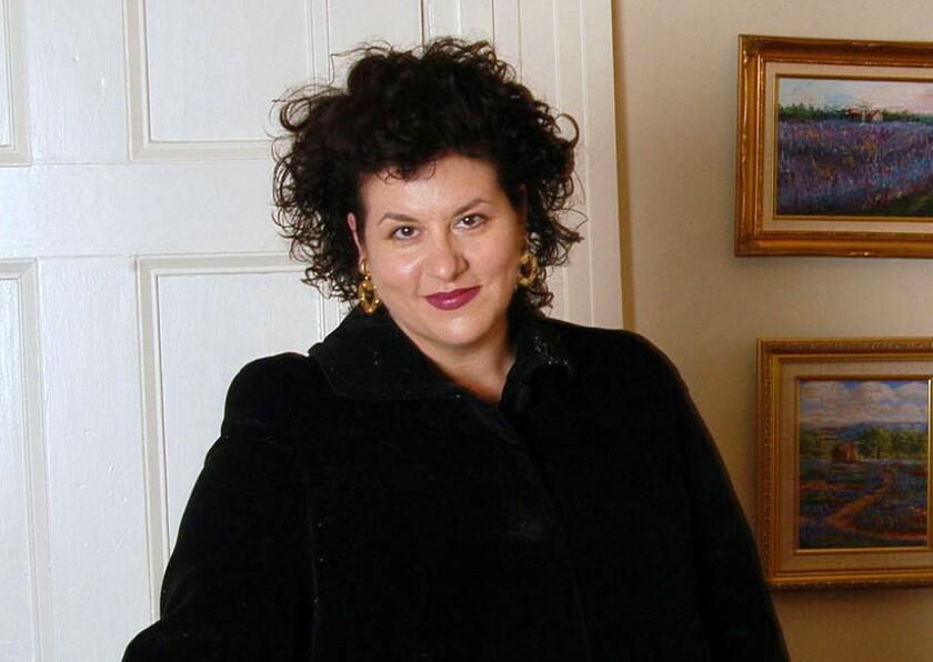 """FILE - This July 28, 2004 file photo shows author Adriana Trigiani in New York. Dutton announced Tuesday, Dec. 3, 2019. that it had reached a two-book deal with Trigiani, whose previous works include """"The Shoemaker's Wife"""" and the """"Big Stone Gap"""" series. (AP Photo/Jim Cooper, File)"""