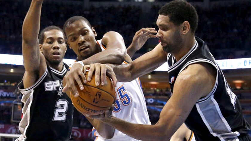 Forward Kevin Durant (35) and the Thunder will have their hands full against forward Kawhi Leonard (2), Tim Duncan and the Spurs when the Western Conference semifinals begin on Saturday.