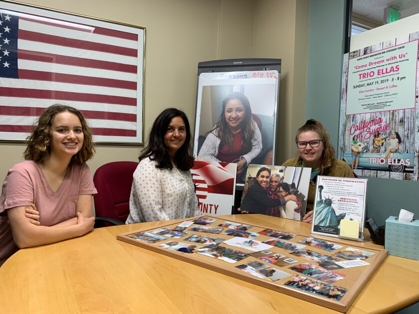 North County Immigration & Citizenship Center Executive Director Linda Martinez Haley, center, is seen in her office with interns Amanda Loren's, left, and Hope Gerdon, right