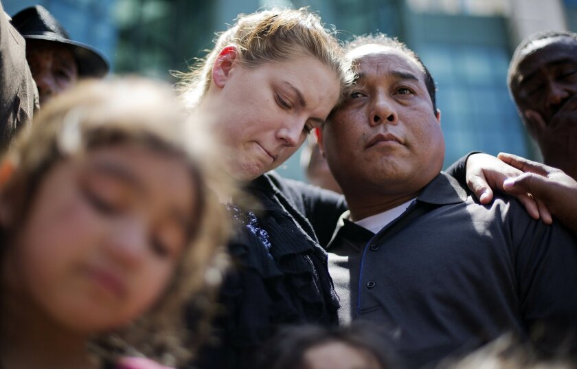 Alecia, left, and Boun Khan Phonesavanh, the parents of 19-month-old Bounkham Phonesavanh who was severely burned by a flash grenade during a SWAT drug raid, attend a vigil outside Grady Memorial Hospital where he is undergoing treatment, Monday, June 2, 2014, in Atlanta. A Georgia state senator says he will ask U.S. Attorney Sally Quillian Yates to investigate the police raid where the Georgia toddler was severely burned by a flash grenade. State Sen. Vincent Fort joined 19-month-old Bounkham Phonesavanh's family at a prayer vigil outside Grady Memorial Hospital in Atlanta on Monday. The boy's mother says a fever may delay a planned surgery. Police have said officers were looking for a suspect who may have been armed and didn't know children were inside. (AP Photo/David Goldman)