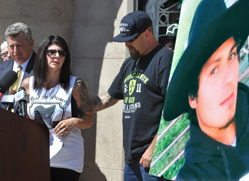 The fatal police shooting of Dylan Noble last month has set off protests and soul searching in Fresno. Noble's mother, Veronica Nelson, and stepfather, Jason Nelson, right, are seen at a news conference after the shooting with a photo of Dylan.