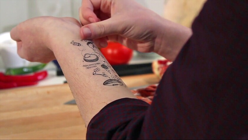 Two Italian design students have created recipe tattoos. They press on, wipe off.