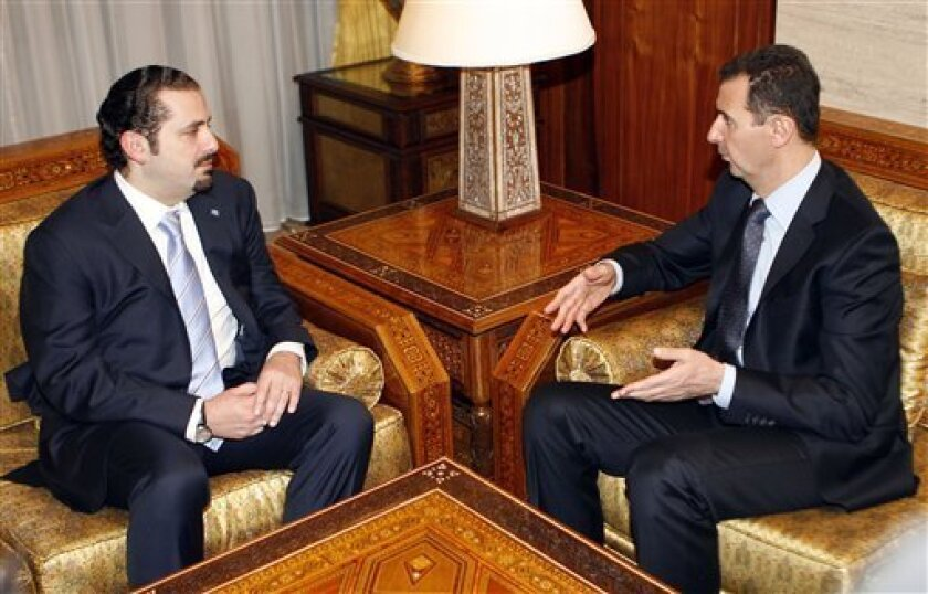 FILE- In this Dec. 13, 2010 file picture, Syrian President Bashar Assad, right, meets with Lebanon's Prime Minister Saad Hariri, at Tishrin presidential palace, in Damascus, Syria. Hariri said in an interview published Monday, he was wrong to accuse Syria of involvement in the 2005 assassination of his father, a major turnaround for a politician who has long blamed Damascus for the Beirut truck bombing that killed Rafik Hariri and 22 others. (AP Photo/Bassem Tellawi, File)