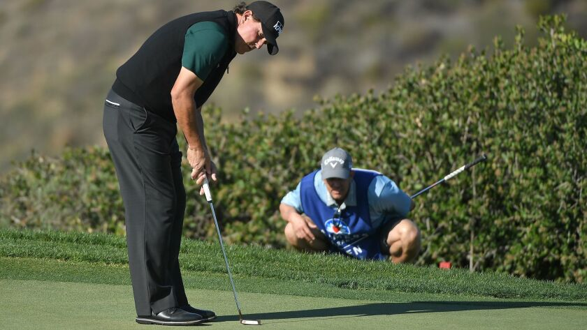 Phil Mickelson putts on the 12th green during the first round of the Farmers Insurance Open at Torrey Pines North on January 25, 2018 in San Diego, California.