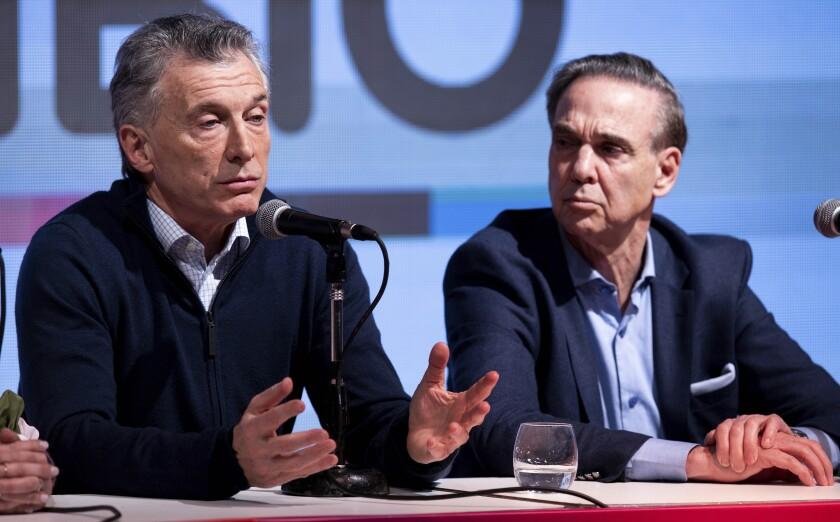 Argentine President Mauricio Macri and running mate Miguel Angel Pichetto