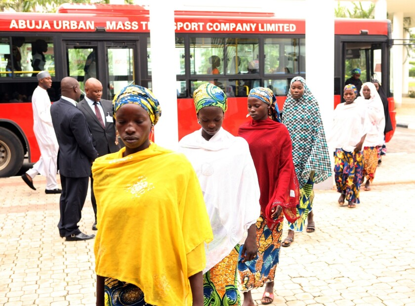 Some of the Chibok schoolgirls who escaped Islamist captors alight from a bus to attend a meeting with Nigerian President Goodluck Jonathan in Abuja on Tuesday.