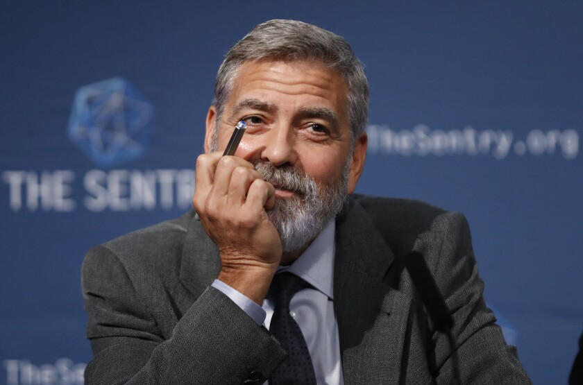 """FILE - In this Sept. 19, 2019 file photo, US actor and activist George Clooney speaks at a press conference in London. George Clooney on Sunday, Oct. 10, 2021. ruled out having a second career in politics, saying he would rather have a """"nice life"""" and says he is looking to reduce his workload. Nevertheless, the 60-year-old actor and director waded into politics during an interview with the BBC's Andrew Marr. Clooney, a long-time supporter of U.S. President Joe Biden, described America as a country that is still recovering from the damage caused by Donald Trump. (AP Photo/Alastair Grant)"""