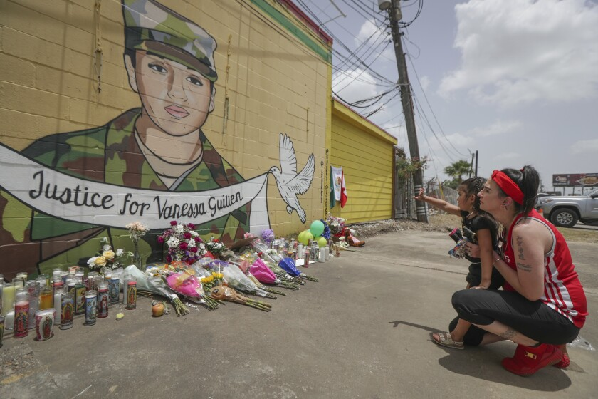 Dawn Gomez and her 3-year-old granddaughter Saryia Greer view a mural honoring Ft. Hood soldier Vanessa Guillén in Houston.