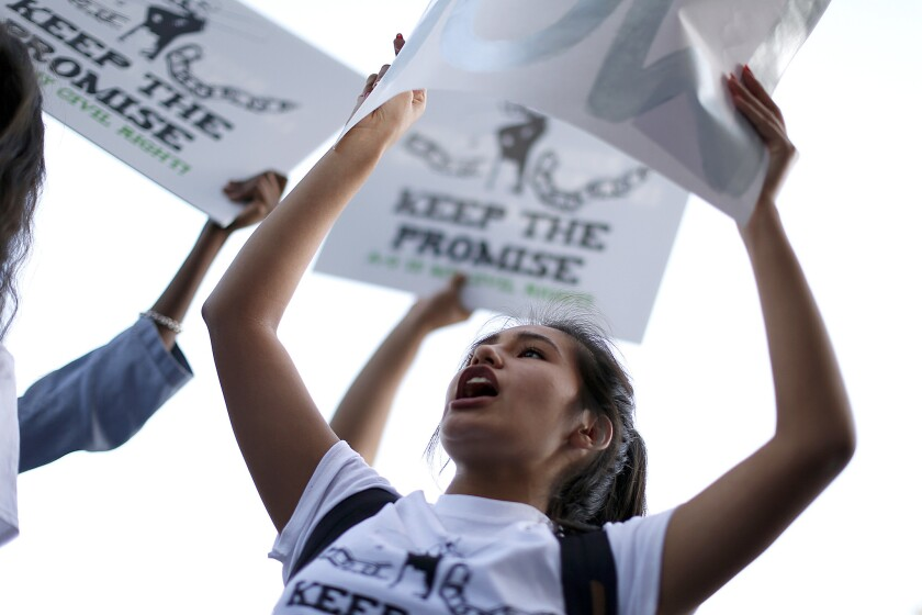 Elayne Jaen, 17, a Crenshaw High School student, takes part in a recent rally about maintaining strong graduation standards in L.A. Unified and helping students achieve them.