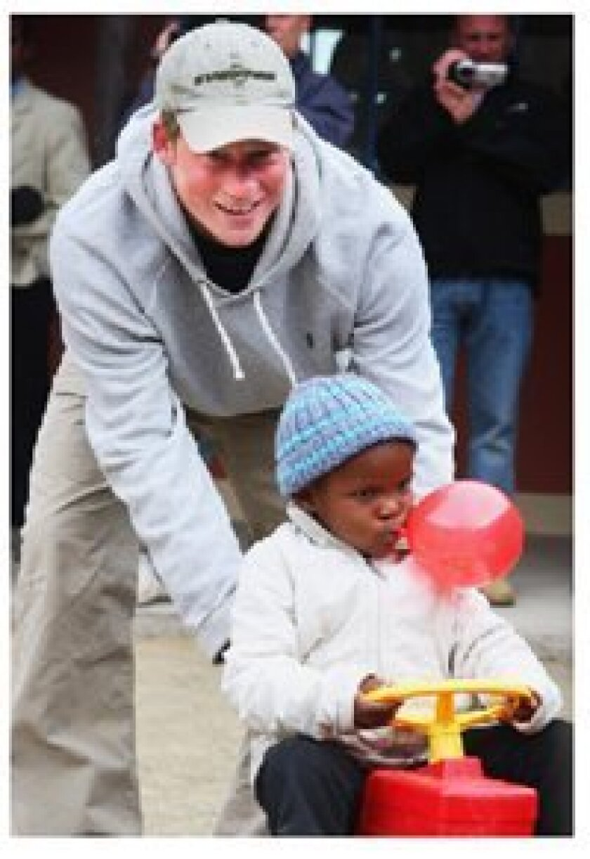 Prince Harry with a child