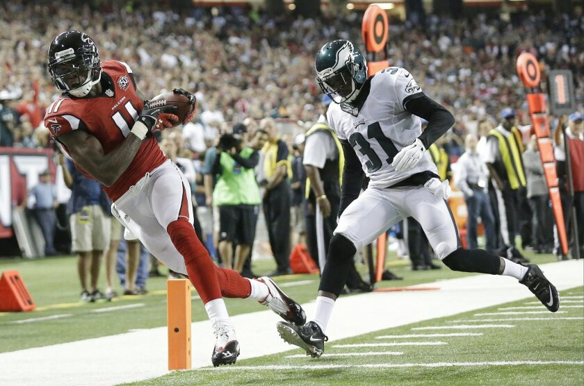 FILE - In this Sept. 14, 2015, file photo, Atlanta Falcons wide receiver Julio Jones (11) makes a touchdown catch against Philadelphia Eagles defensive back Byron Maxwell (31) during the first half of an NFL football game, in Atlanta. Julio Jones is on pace for one of the greatest receiving years in NFL history. (AP Photo/Brynn Anderson, File)