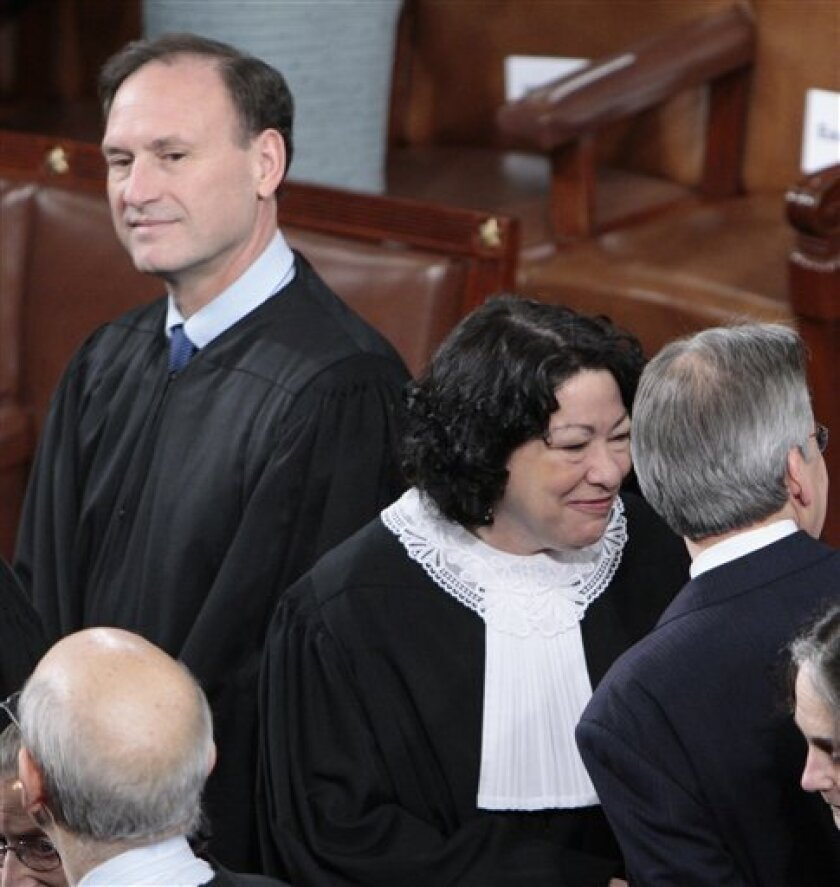 FILE - In this Jan. 27, 2010 file photo, Supreme Court Justice Samuel Alito, left, and Sonia Sotomayor, center, are seen on Capitol Hill in Washington, prior to President Barack Obama's State of the Union address. The Supreme Court's decision on campaign finance has jumbled a seemingly simple rule of American politics _ foreigners should play no role in U.S. elections. Now that the court has declared that corporations have a constitutional right to spend from their general treasuries to support or oppose candidates for president and Congress, the prospect of foreign influence in campaigns has emerged as a flashpoint in the back-and-forth between critics of the ruling and its defenders. (AP Photo/Pablo Martinez Monsivais, File)