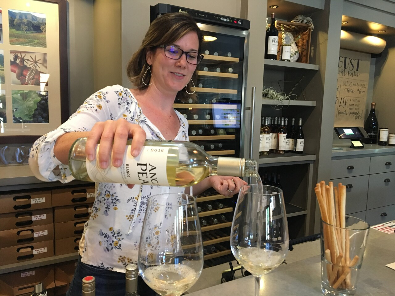 At Ancient Peaks Winery, hospitality manager Alyssa Krichevsky pours 2016 Blanco.