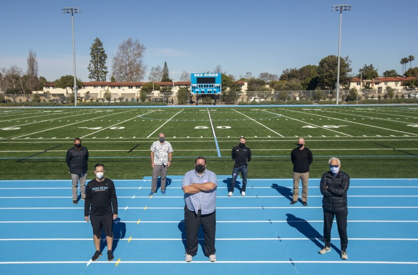 Corona del Mar coaches and staff Jeff Perry,