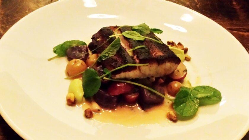 The Porcini-dusted Sea Bass at Vessel restaurant at the Kona Kai Resort & Marina.