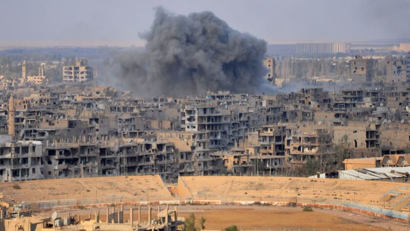 Smoke billows from the eastern Syrian city of Dair Alzour during an operation by government forces against Islamic State on Nov. 3, 2017.