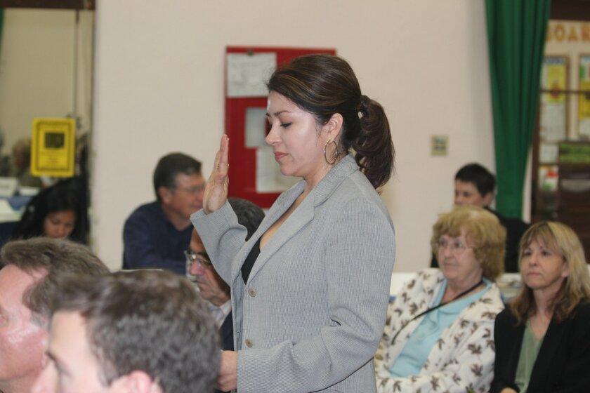 Yolanda de Riquer swears to uphold the tenets of the La Jolla Historical Society.