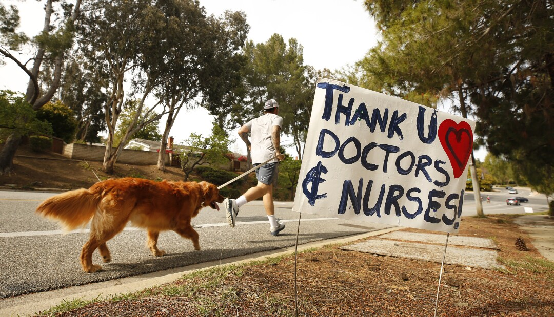 A jogger and his dog on the route to Los Robles Hospital & Medical Center in Thousand Oaks.