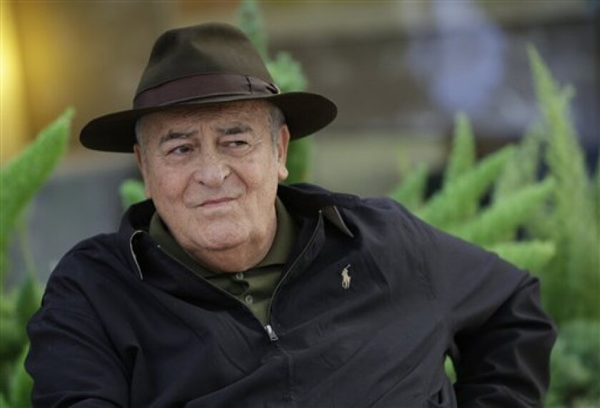 FILE - In this file photo taken on Oct. 18, 2012, Italian film director Bernardo Bertolucci poses for photographers during a photo call in Rome. Bertolucci was chosen Thursday, May 9, 2013, as the president of the jury of 70th edition of the Venice Film Festival that will take place from Aug. 28 to