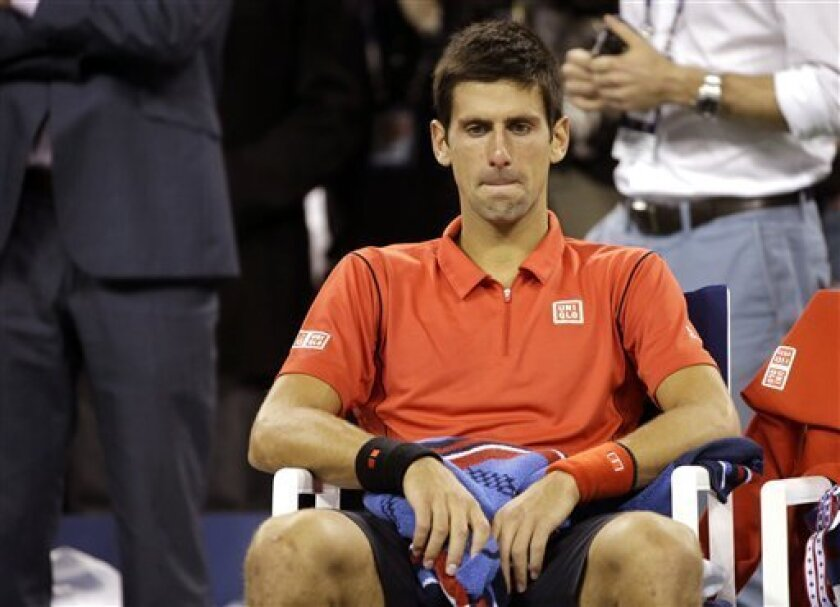 Novak Djokovic, of Serbia, sits in his changeover chair after losing to Rafael Nadal, of Spain, in the men's singles final of the 2013 U.S. Open tennis tournament, Monday, Sept. 9, 2013, in New York. (AP Photo/David Goldman)