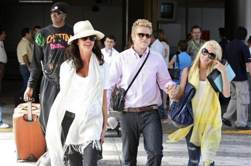 """In this image released by NBC on Friday, May 29, 2009 and taken on May 27, celebrities, from left, John Salley, background, Janice Dickinson, Spencer Pratt and Heidi Montag leave the airport after arriving in San Jose, Costa Rica for the NBC reality show, """"I'm a Celebrity, Get Me Out of Here,"""" whic"""