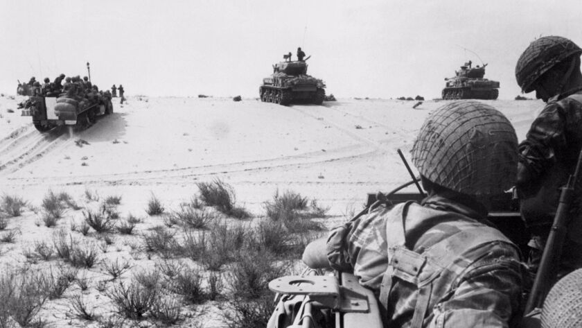 Israeli armored forces in action in the Sinai Desert on June 5, 1967.