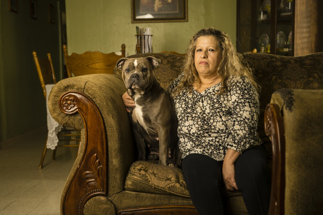 Lucia Salmeron Torres sits in her living room on the outskirts of Fresno County.