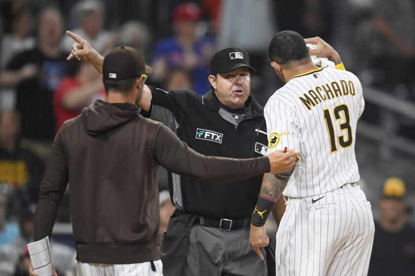 The Padres' Manny Machado  is ejected by umpire Doug Eddings during the eighth inning Friday night.