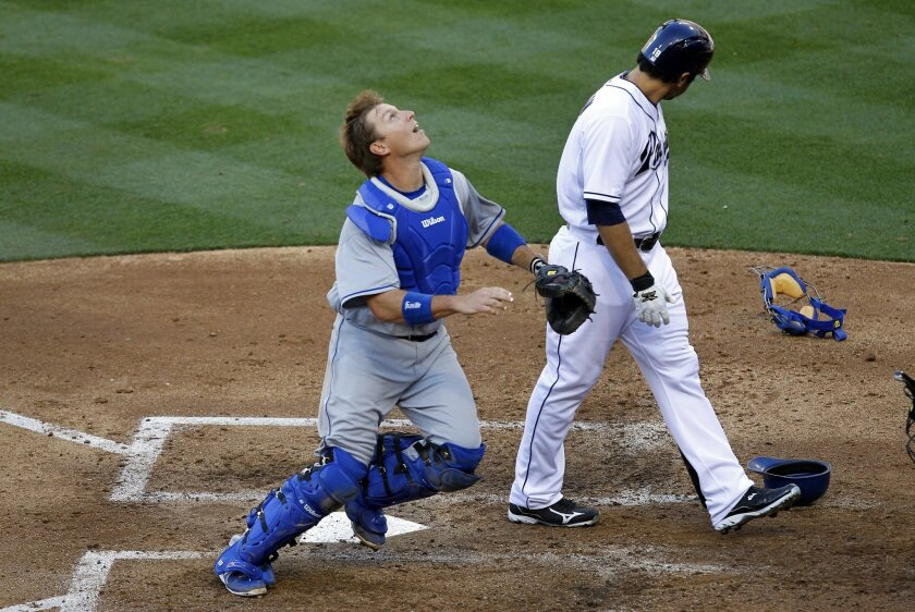 Padres Carlos Quentin interferes with Dodgers catcher A.J. Ellis on a foul ball. Quentin was called out.