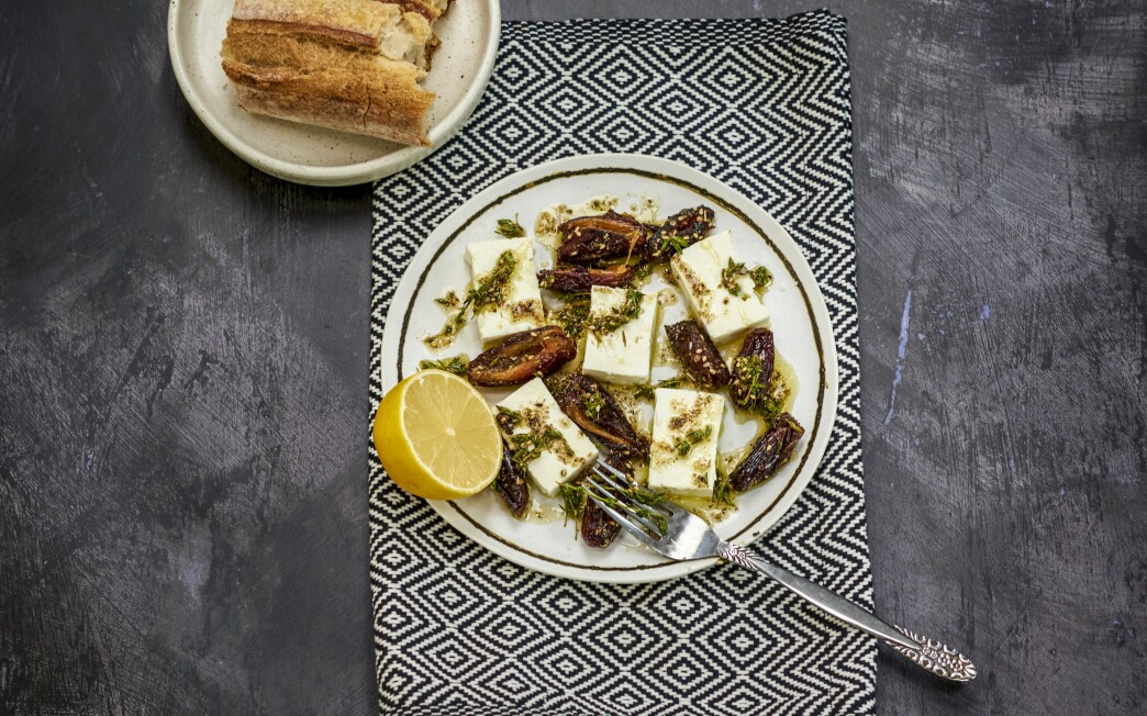 Caramelized, hot dates pair well with cold, creamy feta — all slicked in za'atar-infused olive oil — in this easy appetizer.