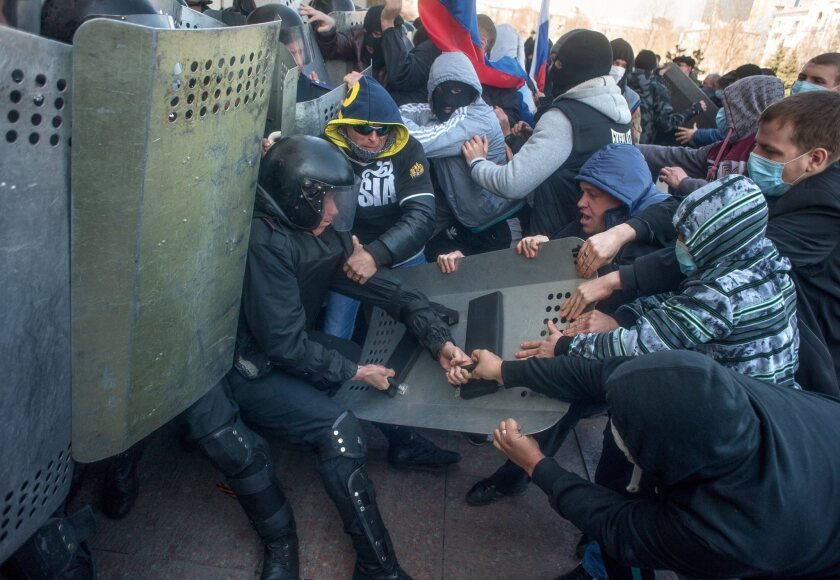 Pro-Russia protesters clash with police Sunday as they try to occupy a regional administration building in Donetsk, Ukraine.