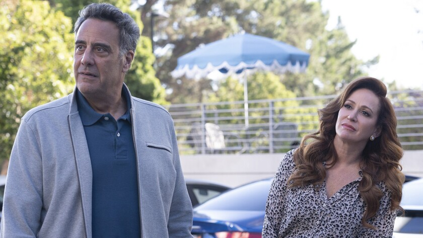 "Brad Garrett and Rebecca Creskoff in a new episode of the comedy ""Single Parents"" on ABC."