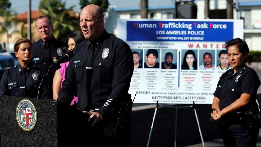 VAN NUYS, CA-AUGUST 29, 2016: LAPD Liutenant Marc Evans addresses the media during press conference