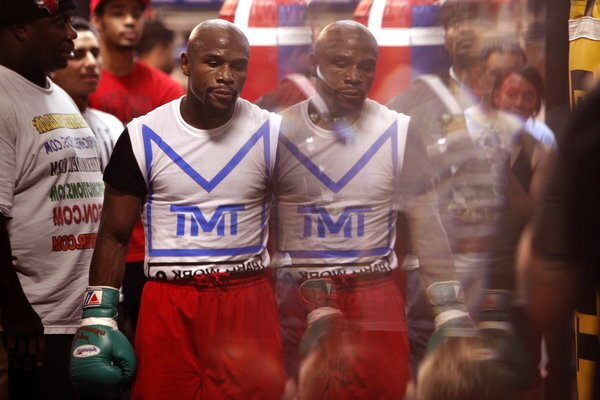 Boxing champion Floyd Mayweather Jr. is reflected in a mirror during a training session at his gym in Las Vegas. The double-image is made in the beveled edge of a mirror.