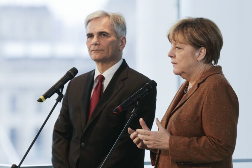 German Chancellor Angela Merkel, right, and her counterpart from Austria Chancellor Werner Faymann brief the media prior to a meeting at the chancellery in Berlin, Germany, Thursday, Nov. 19, 2015. (AP Photo/Markus Schreiber)