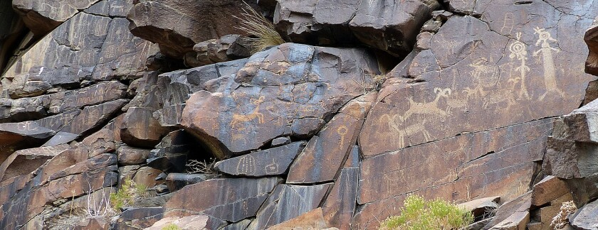 Depending on the time of day and lighting, some petroglyphs are easier to see, right, than others, center.